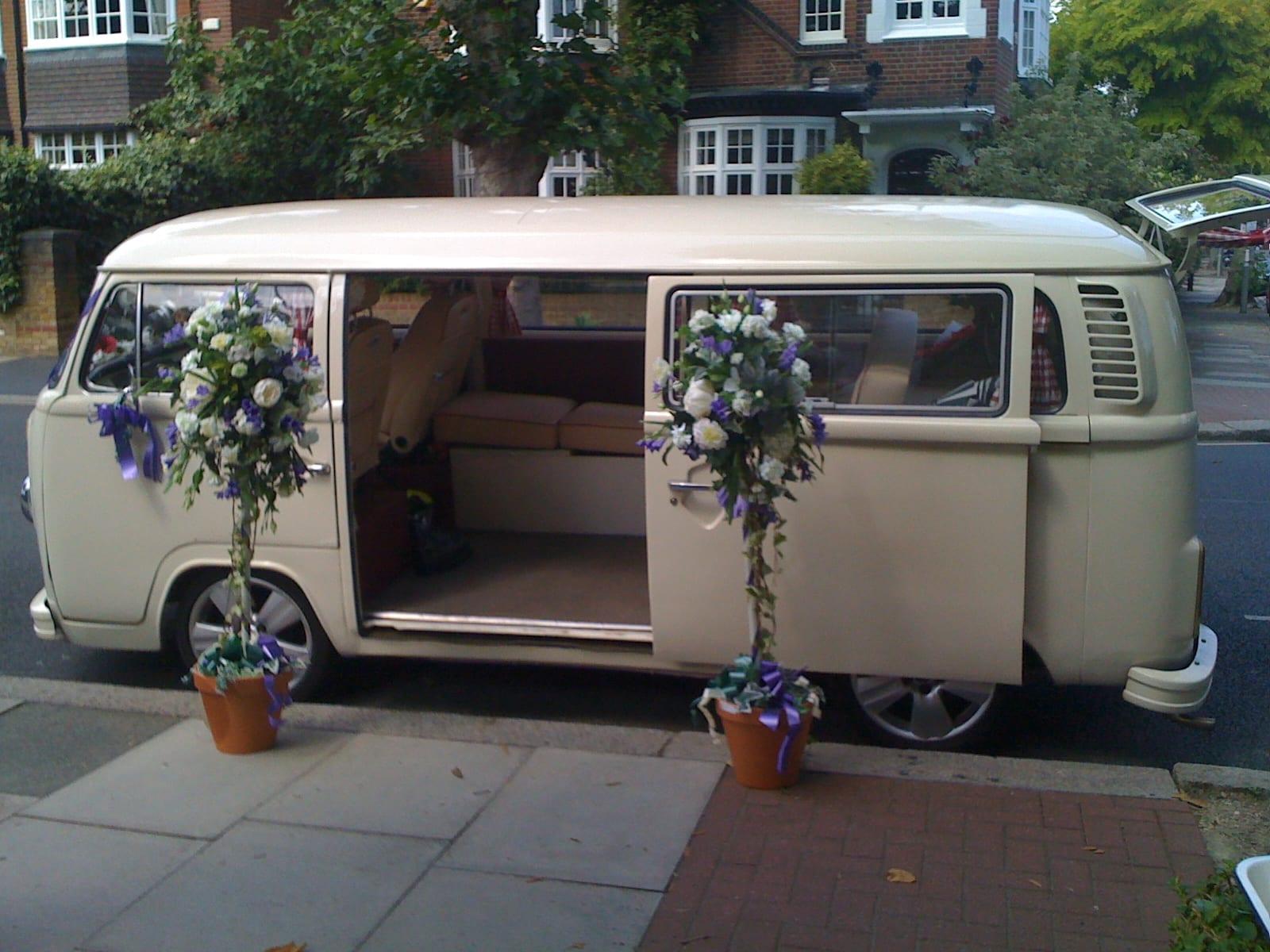 Campervan with wedding flowers