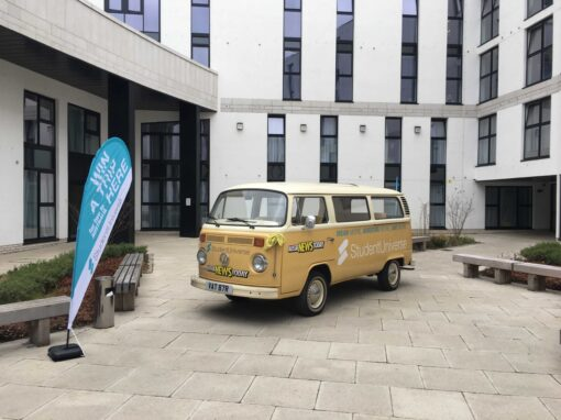 University promotional tour with a branded campervan