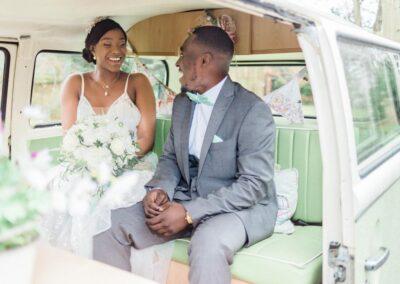 bride and groom in campervan wedding car