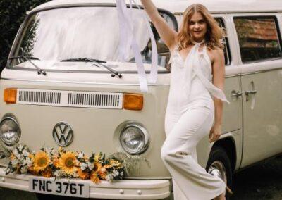 bride with 70s VW Camper wedding car