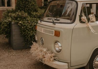 classic campervan wedding car with flowers surrey