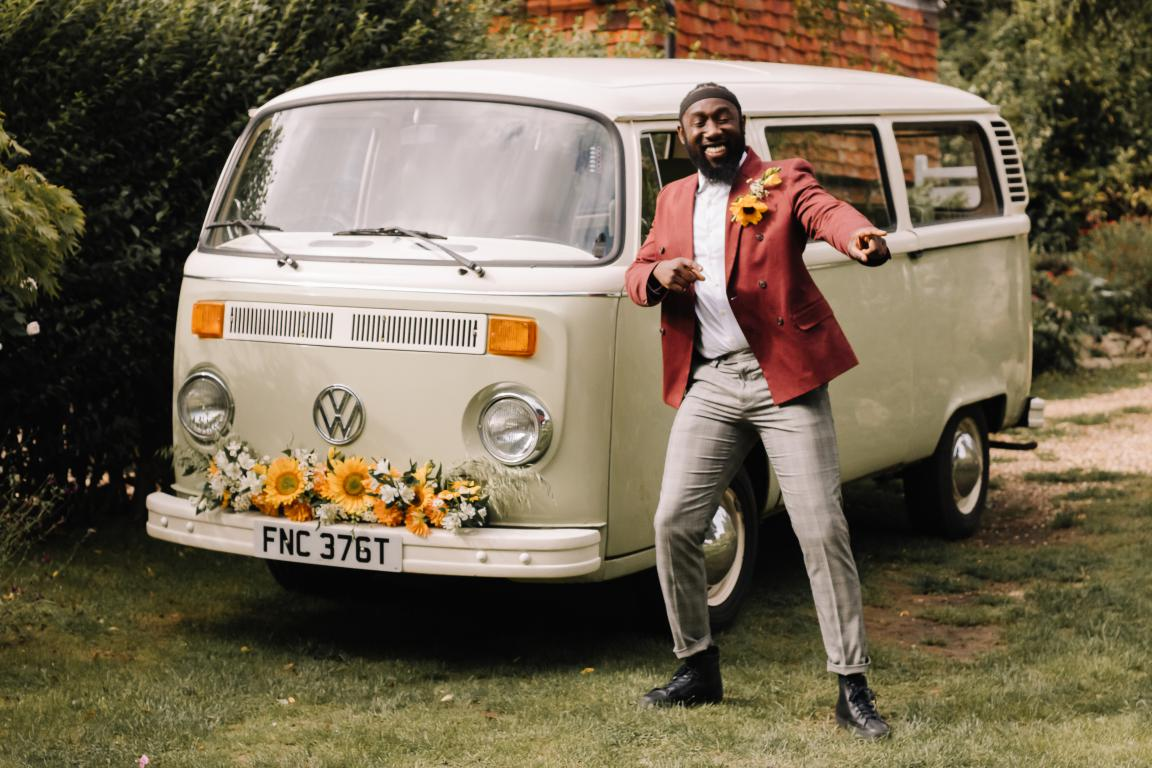 green campervan with sunflowers wedding car