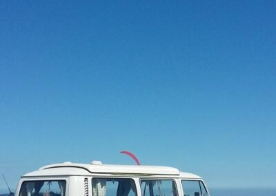 vw camper rental to go to the beach surfer