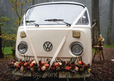 white campervan with flowers for wedding